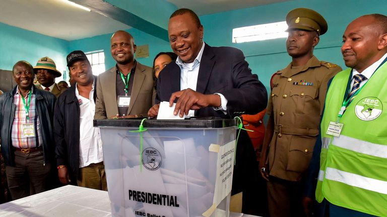 Kenya's President Uhuru Kenyatta casts his ballot