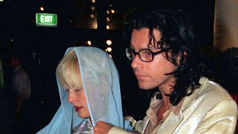 Michael Hutchence with Paula Yates, cradling two-month-old Tiger Lily