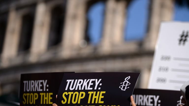 Amnesty International activists hold placards as they protest against the arrest of rights activists in Turkey on 20 July 2017