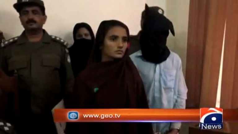 Asiya Bibi is flanked by Pakistani police after her arrest. Pic: Geo News