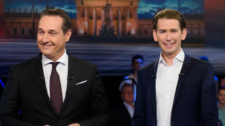 Heinz-Christian Strache (L) and Sebastian Kurz prepare for an election TV debate