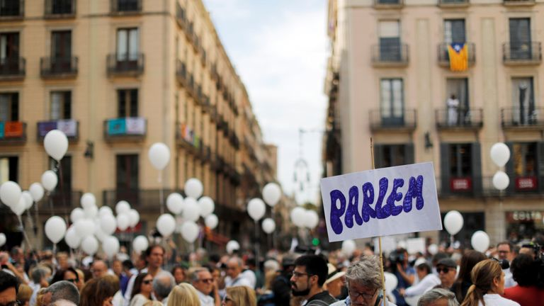 People gather for a demonstration in a square in Barcelona