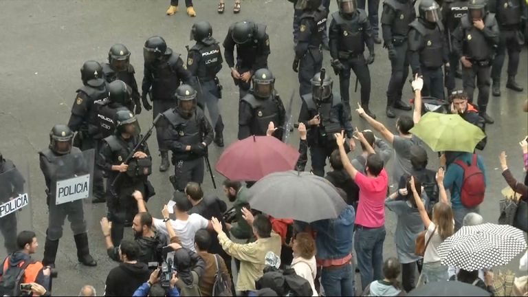 Riot police are outside polling stations in Barcelona