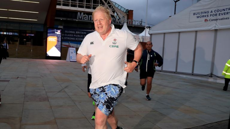 Foreign Secretary Boris Johnson returns to his hotel after an early morning run during the Conservative Party Conference in Manchester