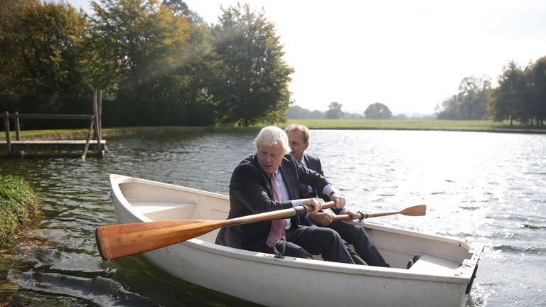 Boris Johnson (L) and Czech Republic's Deputy Foreign Minister Ivo Sramek (R) go out onto a boating lake in a rowing boat before attending a lunch meeting with other European foreign ministers at the British Foreign Secretary's official residence Chevening House