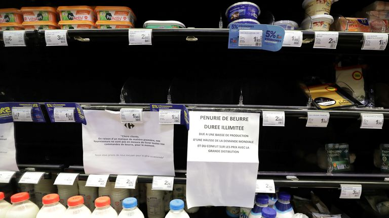 Supermarket shelves in France have signs on them apologising for the lack of butter available