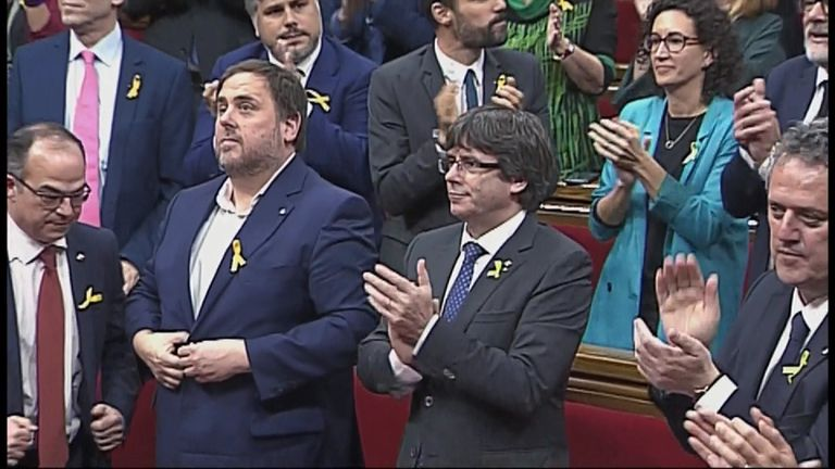 Applause breaks out across Catalan parliament after it votes in favour of declaring independence