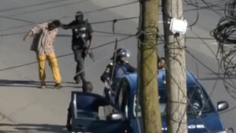 A still image taken from a video shows police arresting a man in the English-speaking city of Buea, Cameroon