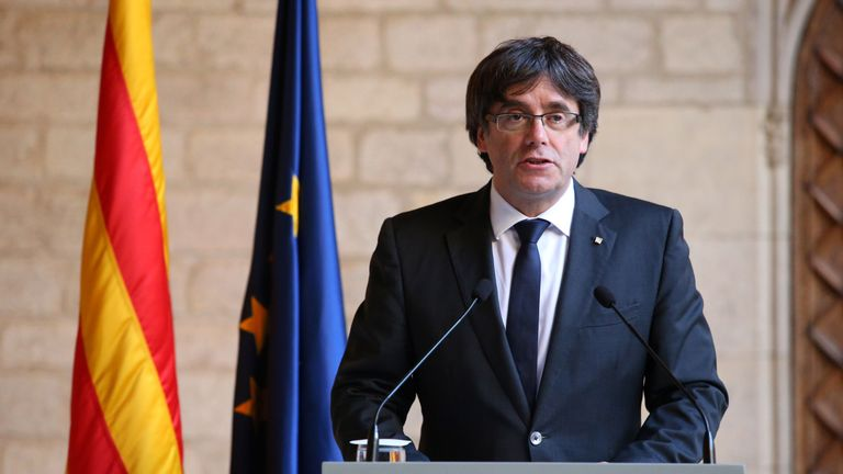 Mr Puigdemont speaking to the Catalan people