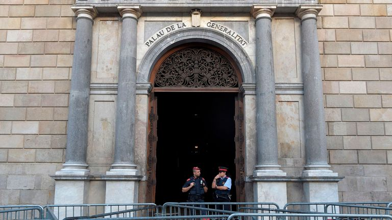 Catalan police officers watch the 'Generalitat' palace in Barcelona