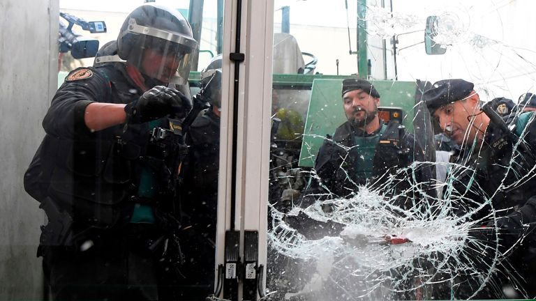 Police smashed their way into a polling station near Girona