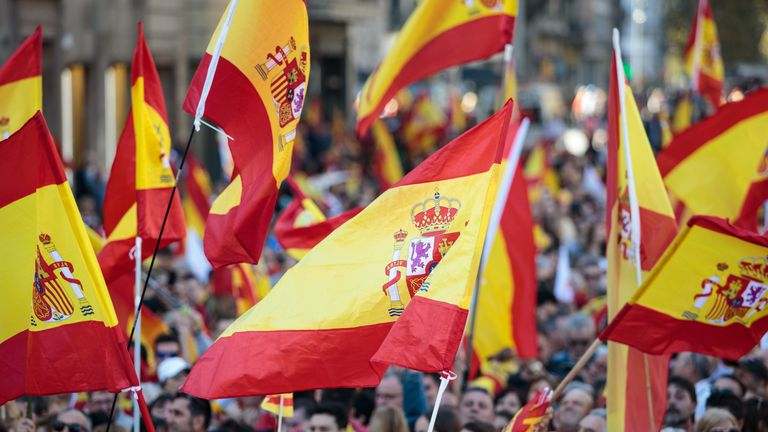 BARCELONA, SPAIN - OCTOBER 29: Protesters wave Spanish flags during a pro-unity demonstration on October 29, 2017 in Barcelona, Spain. Thousands of pro-unity protesters gather in Barcelona, two days after the Catalan Parliament voted to split from Spain. The Spanish government has responded by imposing direct rule and dissolving the Catalan parliament. (Photo by Jack Taylor/Getty Images)