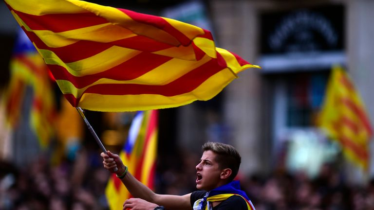 A boy waves a Catalan flag as people celebrate at the Sant Jaume square in Barcelona on October 27, 2017. Catalonia's parliament voted to declare independence from Spain and proclaim a republic, just as Madrid is poised to impose direct rule on the region to stop it in its tracks. A motion declaring independence was approved with 70 votes in favour, 10 against and two abstentions, with Catalan opposition MPs walking out of the 135-seat chamber before the vote in protest at a declaration unlikely