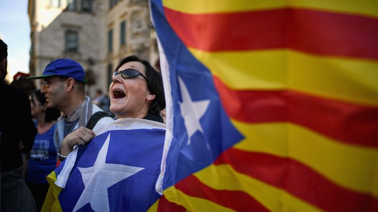 Catalan separatist flags are waved in front of the Generalitat Palace in Barcelona