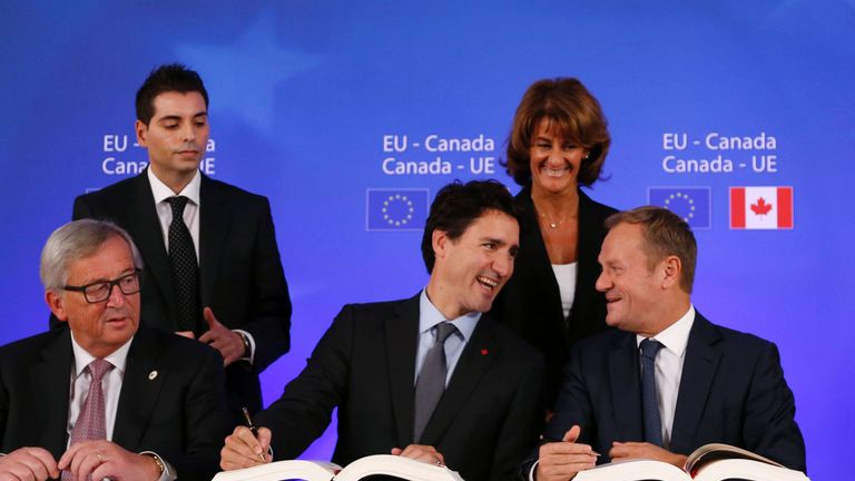 Canada's Prime Minister Justin Trudeau signs the CETA deal in October last year