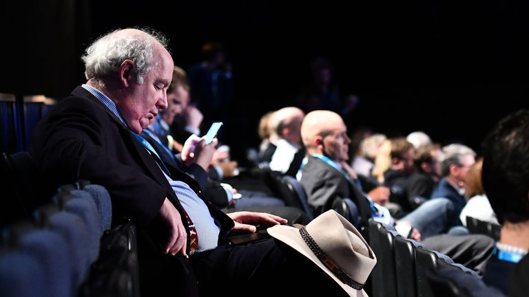 A delegate takes a nap in the back row on the first day of the Conservative Party annual conference at the Manchester Central Convention Centre, in Manchester on October 1, 2017