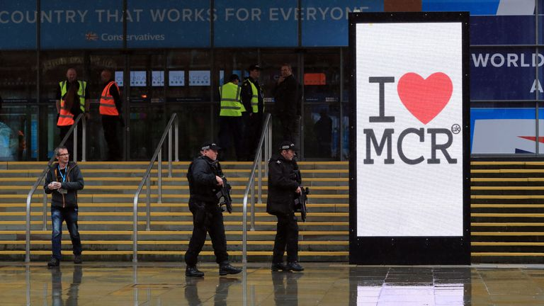 Armed police patrol outside the Manchester Central Convention Complex