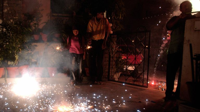 An Indian family sets off fireworks during Diwali, the 'festival of lights'