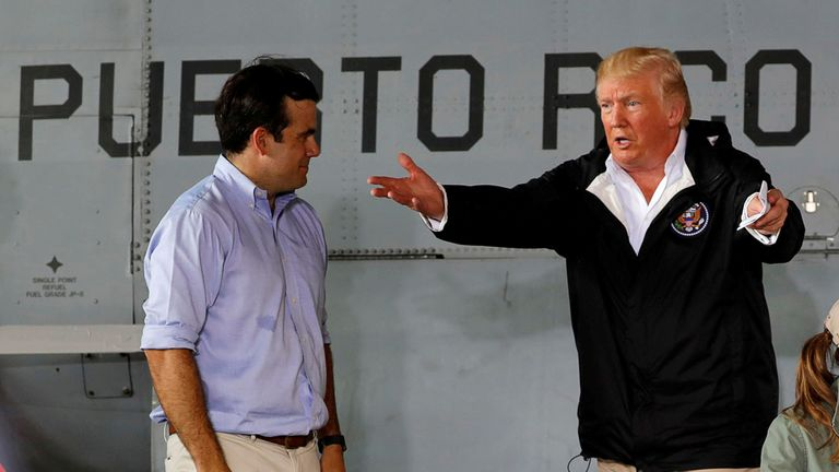 Donald Trump talks with Puerto Rico Governor Ricardo Rossello (left)