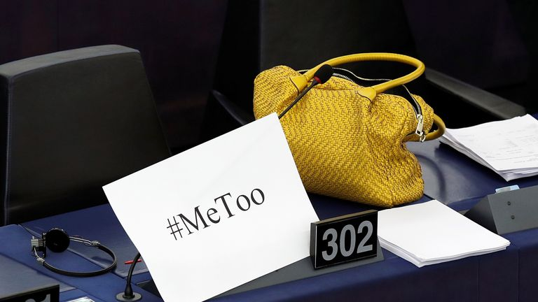 "A placard with the hashtag ""MeToo"" is seen on an MEP's desk during the debate"
