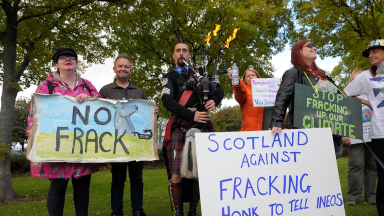Scottish protesters with placards outside a site in Grangemouth
