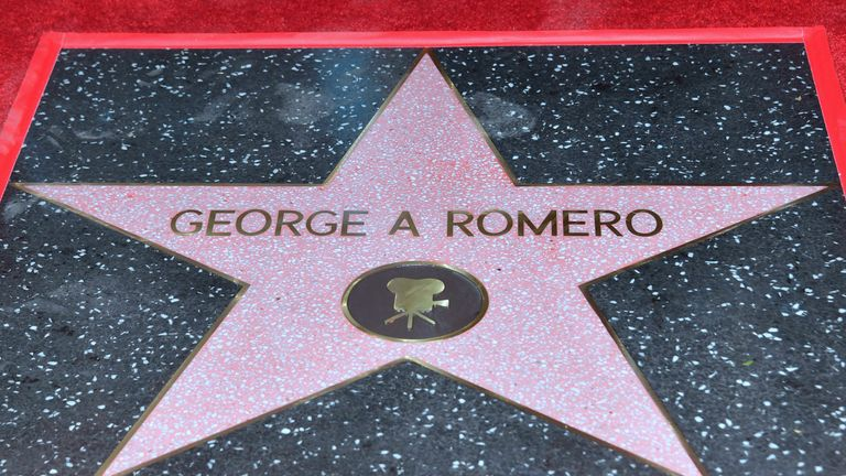 George Romero's star is unveiled at the posthumous Star ceremony for the late actor on the Hollywood Walk of Fame on October 25, 2017 in Hollywood, California, where the famed filmaker of classic horror movies was honoured with the 2,621st star in the category of Motion Pictures. / AFP PHOTO / FREDERIC J. BROWN (Photo credit should read FREDERIC J. BROWN/AFP/Getty Images)