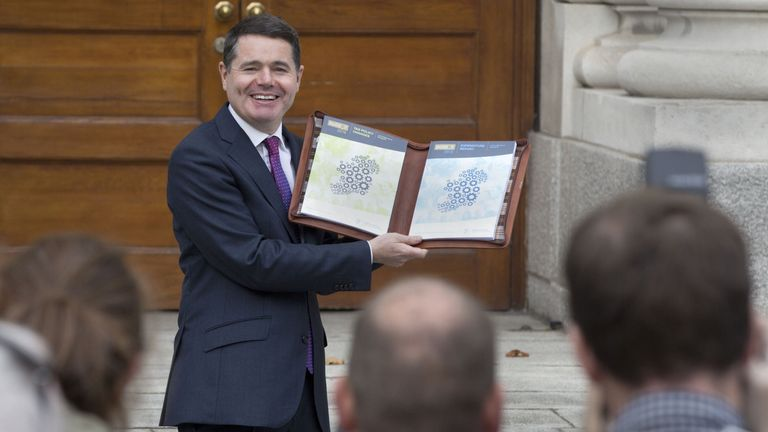 Irish Finance Minister, Paschal Donohoe with a copy of Ireland's 2018 budget