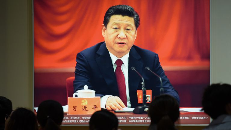 his picture taken on October 10, 2017 shows a portrait of Chinese President Xi Jinping at an exhibition showcasing China's progress in the past five years at the Beijing Exhibition Centre