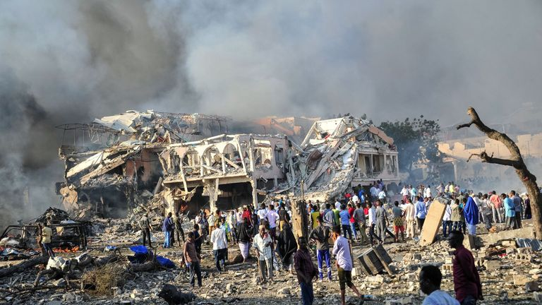 Men and Somalian soldiers arrive on the site to rescue victims of the explosion of a truck bomb in the centre of Mogadishu, on October 14, 2017