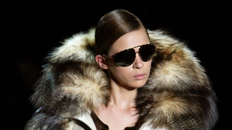 Model wearing a leather Gucci jacket with a fur neck