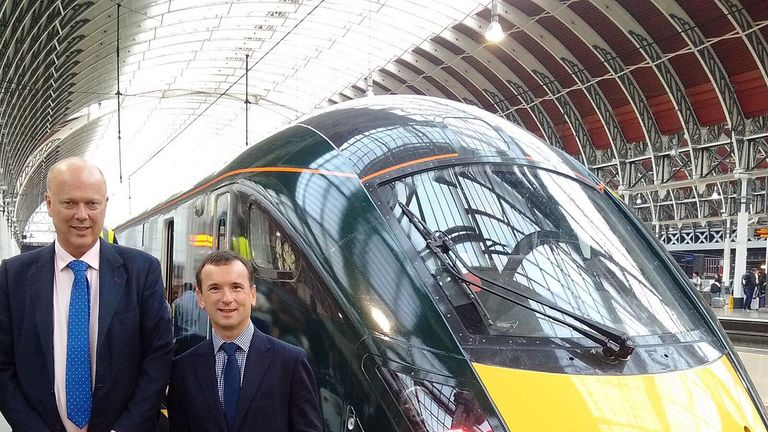 Chris Grayling, left, and Wales Secretary Alun Cairns after arriving 41 minutes late at Paddington Station, London
