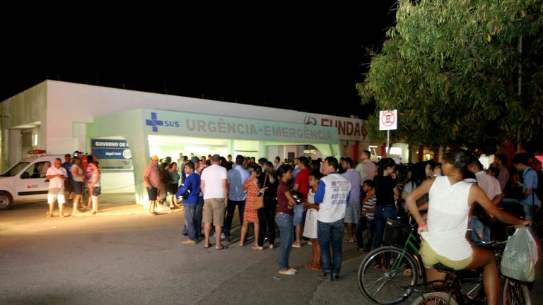 People wait for news outside Janauba's hospital, Minas Gerais State, regarding the victims of the municipal daycare centre, after a watchman sprayed children with alcohol and set them on fire in Janauba, Minas Gerais State, on October 5, 2017
