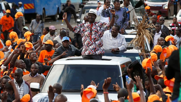 Nairobi, KenyaKenyan opposition leader Raila Odinga, the presidential candidate of the National Super Alliance (NASA) coalition, greets his supporters during a rally at the Uhuru Park in Nairobi, Kenya October 25, 2017. REUTERS/Siegfried Modola