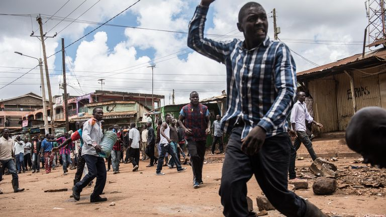 National Super Alliance (NASA) supporters shouting 'No raila no peace', gather to build up barricades to block roads in area 56 in Kawangare district in Nairobi, on October 26, 2017. Kenyans trickled into polling stations on October 26 for a repeat election that has polarised the nation, amid sporadic clashes as supporters of opposition leader ignored his call to stay away and tried to block voting. / AFP PHOTO / Fredrik Lerneryd (Photo credit should read FREDRIK LERNERYD/AFP/Getty Images)