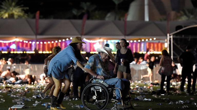 A man in a wheelchair is taken away from the Route 91 Harvest country music festival