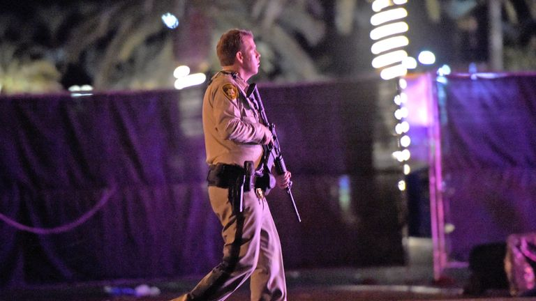 Las Vegas police patrol along the streets outside the the Route 91 Harvest country music festival grounds