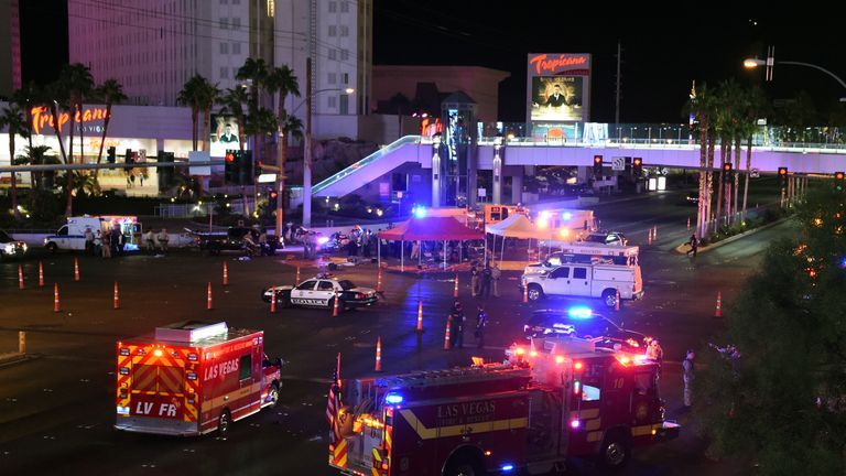Police and rescue personnel gather at the intersection of Las Vegas Boulevard and Tropicana Ave