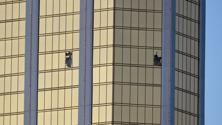 Broken windows are seen on the 32nd floor of the Mandalay Bay Resort and Casino