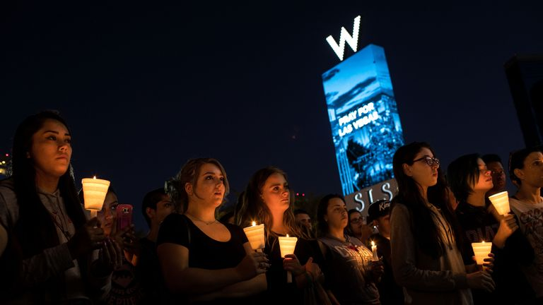 Mourners attend a candlelight vigil in Las Vegas