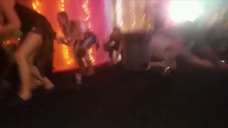 Concert-goers duck for cover as gunfire is heard at a Las Vegas gig.