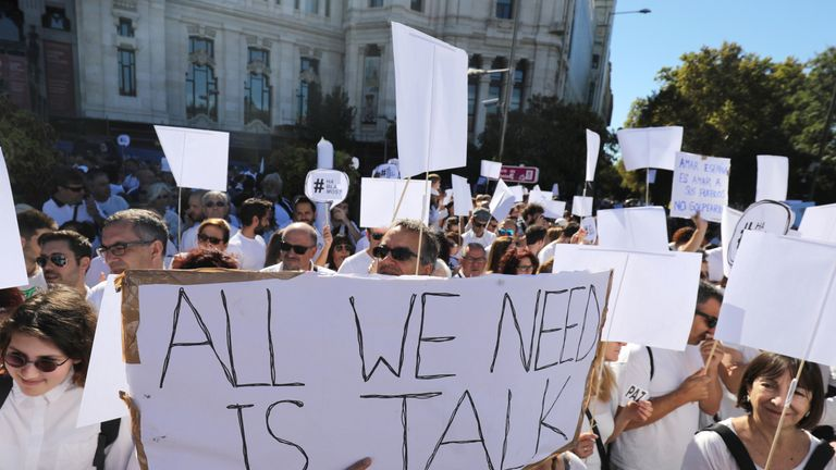 Thousands of people marched in Madrid - many calling for further dialogue