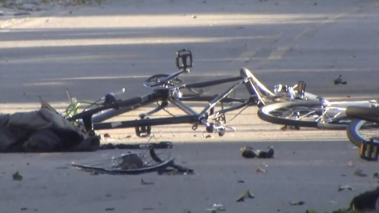 A mangled bicycle lays on the ground