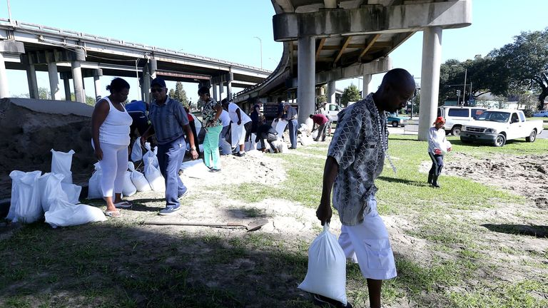 People fill sand bags in New Orleans ahead of the storm's arrival
