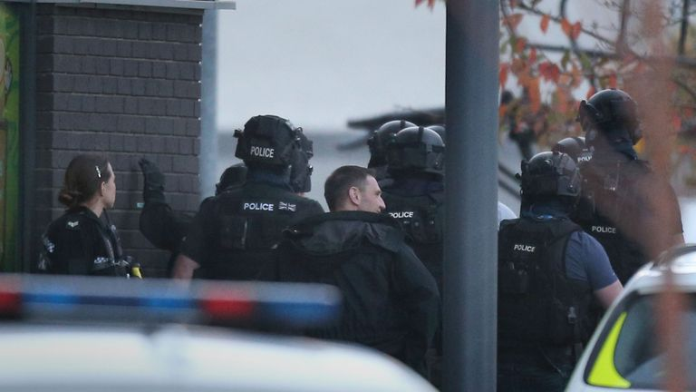 Police in Nuneaton where a gunman is holding two bowling alley members of staff hostage