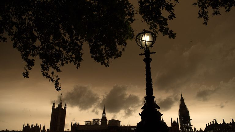 Prime Minister Theresa May Leaves Downing Street For Talks With European Commission President Jean-Claude Juncker LONDON, ENGLAND - OCTOBER 16: A street lamp is lit opposite the Houses of Parliament during a reddish sky caused by remnants of Hurricane Ophelia dragging in dust from the Sahara Desert, on October 16, 2017 in London, England. The hurricane comes exactly 30 years after the Great Storm of 1987 which killed 18 people and is estimated to have caused 1bn GBP in damage to property and inf