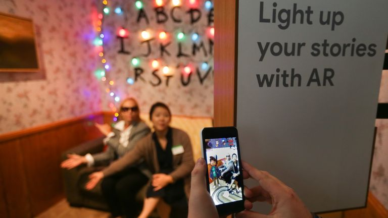 Attendees demo the augmented reality integration of the new Google Pixel 2 smartphone