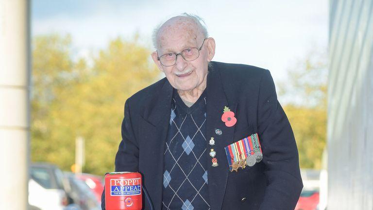 Ron Jones collects outside a Tesco supermarket