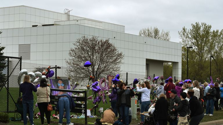 Prince fans leave balloons and flowers at the singer's Paisley Park Complex