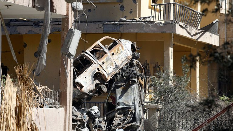 Destroyed vehicles between houses in a residential district at the frontline in Raqqa