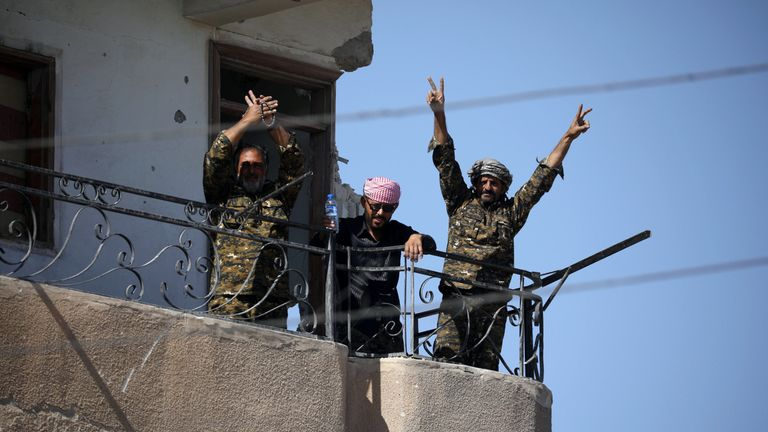 "Fighters of Syrian Democratic Forces gesture the ""V"" sign at the frontline in Raqqa"